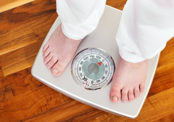 How often should I weigh myself while I am trying to lose weight